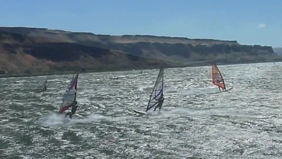 """""""The Wall""""  by Mike GodseyThe smear of bright red all over the iwindsurf.com forecast tables for the Gorge foretold the story...powerful winds focused in the Maryhill to Roosevelt corridor of the eastern Gorge. Since Arlington looked TOO windy with an average of 43 knots I headed to The Wall. The wind direction was not perfect for the fabled huge smooth swell The Wall is famous for but it still was pretty epic. The video tells rest of the story with men on 3.2 to 3.5 sails and the women on 2.8s.Mike Godseyiwindsurf.comBuy the Fleetwood Mac music """"Rhiannon"""" from Amazon.   mike@iwindsurf.com   Home Page"""