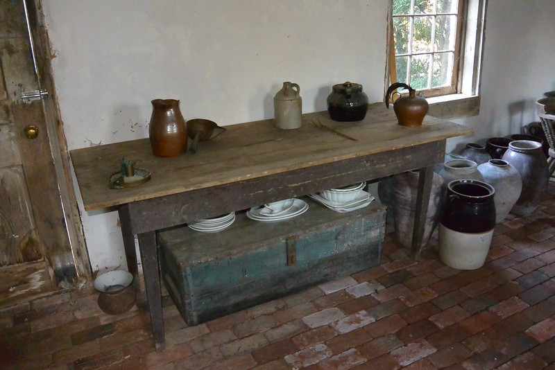 the original outdoor kitchen still set up with items traditional to the home