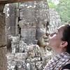 kissing a Buda statue