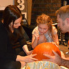 Pumpkin carving family style, love this shot
