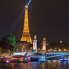 Eiffle tower in the evening with the Pont Alexandre III in the foreground