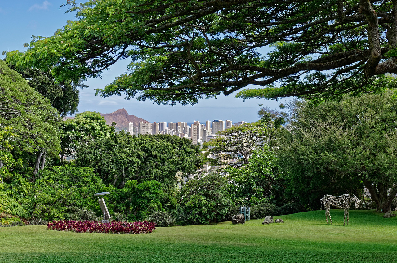 View of Diamond Head and downtown Honolulu from the terrace of Spalding House, once a private residence, now a part of what has become the Honolulu Museum of Art. The mobile sculpture, left foreground, is George Rickey's <i>Breaking Column;</i> the horse is by Deborah Butterfield.