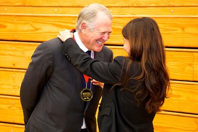 David Cohn accepts the award from Sonya Christian on behalf of Morris Chain.