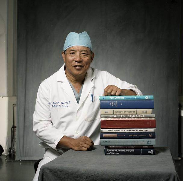 101494_618<br /> DR. KENT WU (ORTHOPEDICS) W/ ALL THE BOOKS HE HAS PUBLISHED 1997