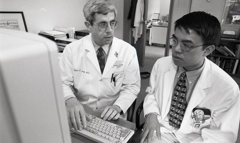 101494_416<br /> DR. DAVID LEACH WITH MED STUDENT VINH NGUYEN,1996