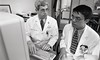 101494_416<br /> DR. DAVID LEACH WITH MED STUDENT VINH NGUYEN,1996
