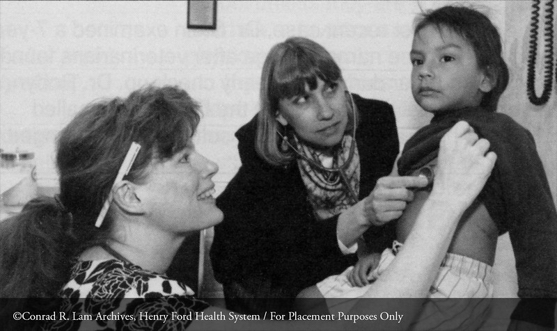 Drs. Susan Schooley and Christine Jerpbak  with a patient at the CHASS community center, 1992