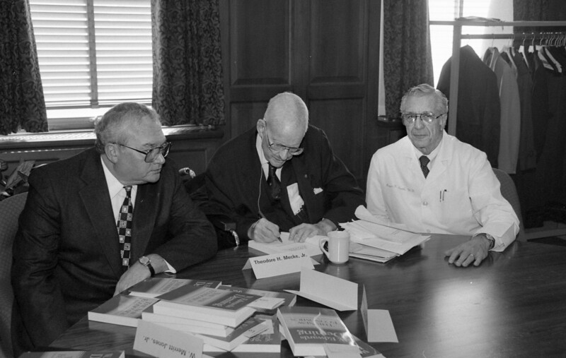 101494_002 W. Edwards Deming autographs his books for Gail Warden (left) & Dr. Roger Smith, 1993