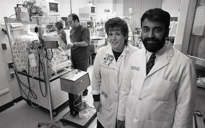 CHRIS NEWMAN AND DR. EZHUTHACHAN OF NICU, 1995