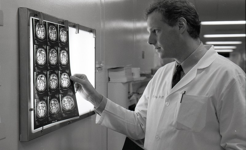 101494_450<br /> DR. JAMES PEABODY EXAMINING X-RAYS 1996