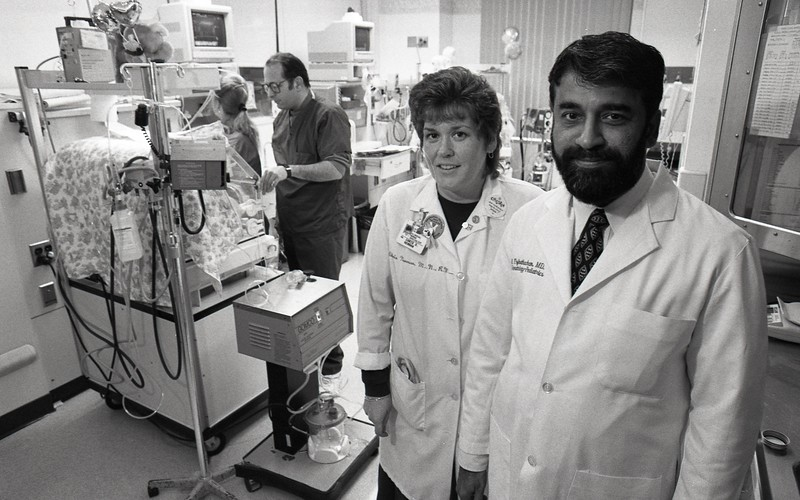 101494_206<br /> CHRIS NEWMAN AND DR. EZHUTHACHAN OF NICU, 1995