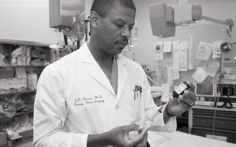 101494_145<br /> DR.EMANUEL  RIVERS OF EMEGENCY MEDICINE WITH AN EPINEPHRINE VIAL, 1994