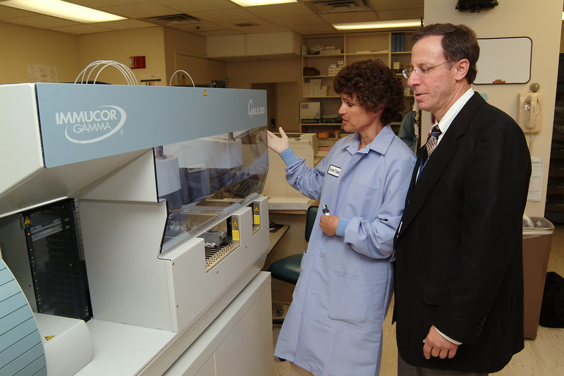 Dr. Richard Zarbo of Pathology with lab tech reviews new equipment, 2004