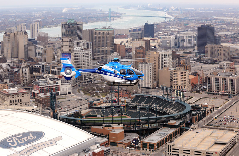HFH helicopter over Detroit skyline