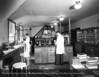 Dr. Oliver Gaebler and technician Irma Hill in the third floor service building laboratory in 1931. From the Collections of The Henry Ford. THF117457 (core)
