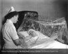 A Henry Ford Hospital nurse using the liquid oxygen tent designed by Dr. Frank Hartman in 1948. From the Collections of The Henry Ford. THF117533 (core)