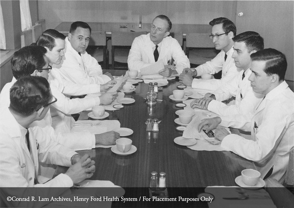 Dr. Richmond Smith with interns, May 1, 1968. From the Conrad R. Lam Collection, Henry Ford Health System. ID=05-021