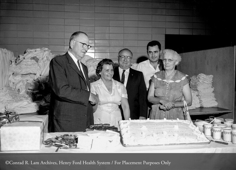 Robin C. Buerki, M.D. and Mamie McClure at her retirement party in the hospital laundry, 1959. From the Conrad R. Lam Collection, Henry Ford Health System. ID=05-046