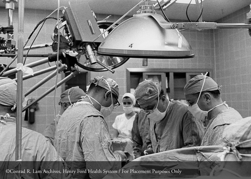 Dr. D. Emerick Szilagyi of Vascular Surgery in the operating room, c.1960. From the Conrad R. Lam Collection, Henry Ford Health System. ID=05-001