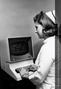 A Henry Ford Hospital nurse using an early computer at a nurses station, October 1968. From the Conrad R. Lam Collection, Henry Ford Health System. ID=05-048