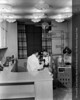 Henry Ford Hospital Department of Opthalmology examination, c.1955. From the Conrad R. Lam Collection, Henry Ford Health System. ID=05-009