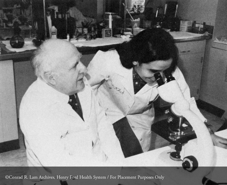 Drs. John Rebuck and Rita Khera in the Pathology laboratory, c.1980. From the Conrad R. Lam Collection, Henry Ford Health System. ID=06-009