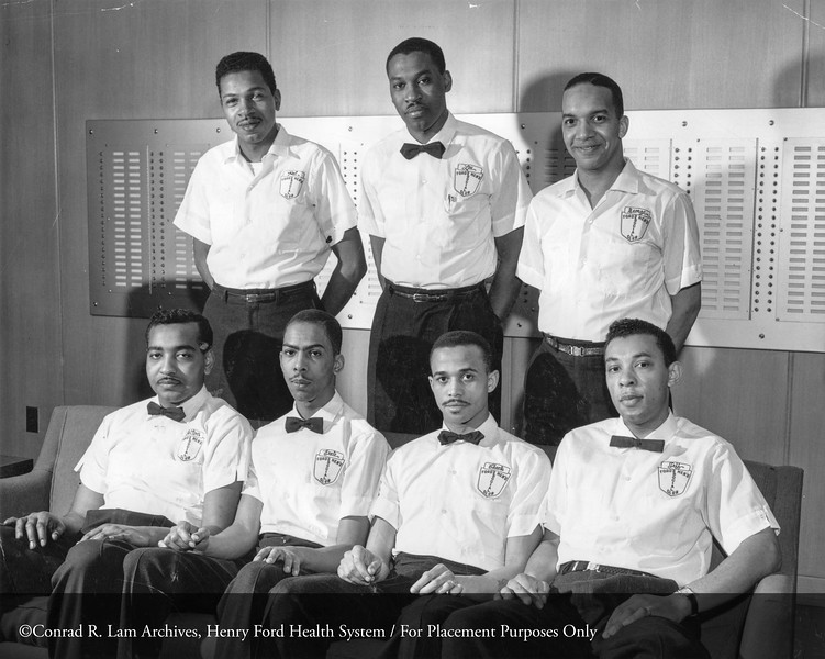 The Fordsmen's Club, 1961. First row left to right: Felton Petty, Ernest Slaton, Charles Robinson and Fletcher Jefferson. Back row left to right: Virgil Waters, Lee Gooden and George Smith. (Robert Haskett not shown) From the Conrad R. Lam Collection, Henry Ford Health System. ID=06-004