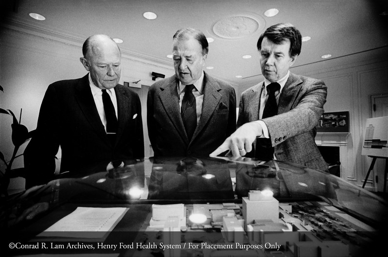 Stanley Nelson, executive vice-president, Henry Ford II and Carlton M. Higbie, Jr., board president, reviewing the model for HFH, 1978. From the Conrad R. Lam Collection, Henry Ford Health System. ID=07-017