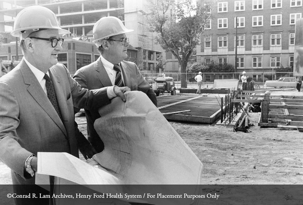 Benson Ford and William Baldwin reviewing the construction plans for the Henry Ford Hospital new student housing, 1976. From the Conrad R. Lam Collection, Henry Ford Health System. ID=07-009
