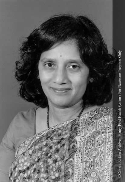 Dr. Sudha Kini of the Department of Pathology, 1989. From the Conrad R. Lam Collection, Henry Ford Health System. ID=08-009