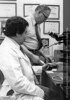 Dr. Michael Parfitt with Dr. Antonio Villaneuva of the Department of Bone and Mineral, c.1974. From the Conrad R. Lam Collection, Henry Ford Health System. ID=08-035