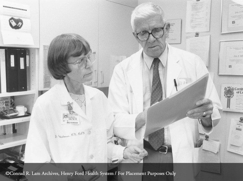 Dr. Fred Whitehouse with Iris Whitehouse, R.N., in endocrinology consultation, c.1989. From the Conrad R. Lam Collection, Henry Ford Health System. ID=08-007