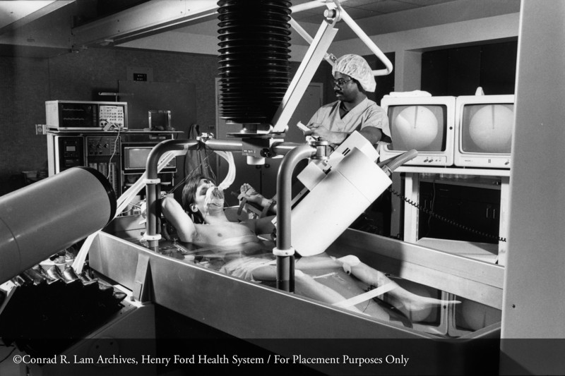 Dr. Raymond Littleton of the Department of Urology in a percutaneous nephroscope extraction procedure to remove renal stones, 1983. From the Conrad R. Lam Collection, Henry Ford Health System. ID=08-008