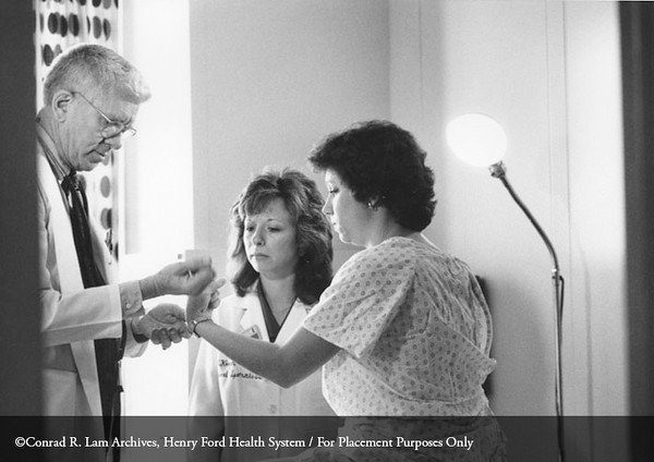 Dr. Fred Whitehouse and Davida Kruger, R.N., of the Department of Endocrinology with patient, 1989. From the Conrad R. Lam Collection, Henry Ford Health System. ID=08-016