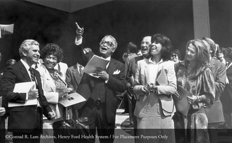 The Honorable Coleman Young, Mayor of the City of Detroit, at the dedication ceremony of the Eleanor Clay Ford Pavilion with Doug Peters, Erma Henderson, Cynthia Ford, Kathleen Ford and Edsel Ford II, September 10, 1982. From the Conrad R. Lam Collection, Henry Ford Health System. ID=09-001