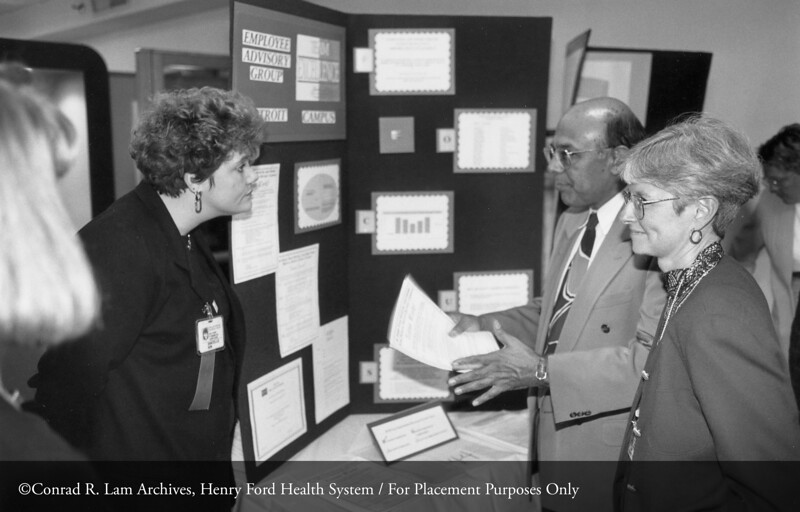 Vinod Sahney, Ph.D. and Mary Viduarri at a Henry Ford Hospital Quality Expo, c.1985. From the Conrad R. Lam Collection, Henry Ford Health System. ID=09-017