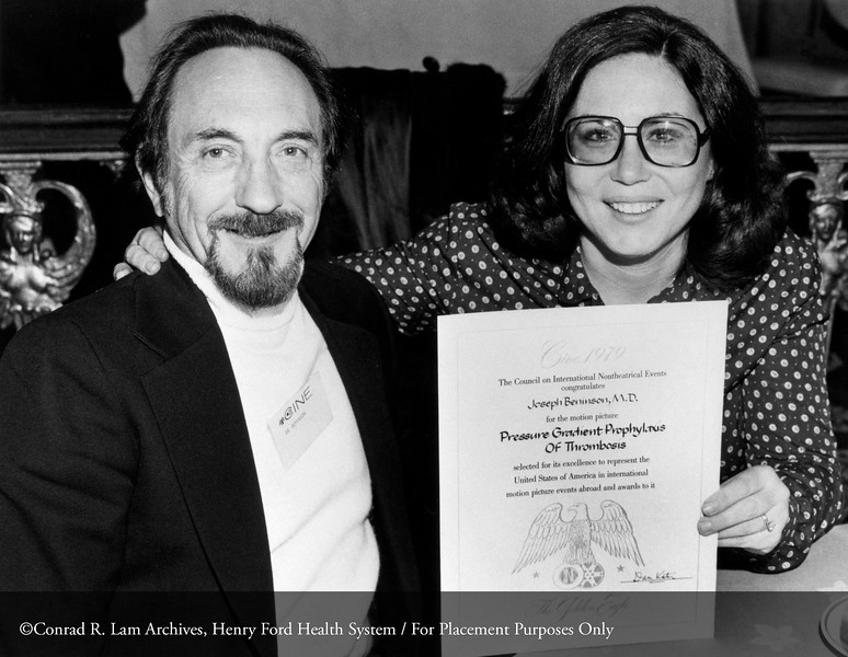 Dr. Joseph Beninson and his wife Evelyn Beninson accepting the Golden Eagle Motion Picture Award from the Council on International Nontheatrical Events, Washington, DC, 1979. From the Conrad R. Lam Collection, Henry Ford Health System. ID=09-034