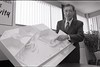 101494_756<br /> DR. BORSAND WITH ARCHITECTURAL RENDERINGS OF SUPERVISON CENTERS, HFHS 1ST OPTEMTRY FUTURE PLANS, ROSEVILLE, OPTOMETRY 1997