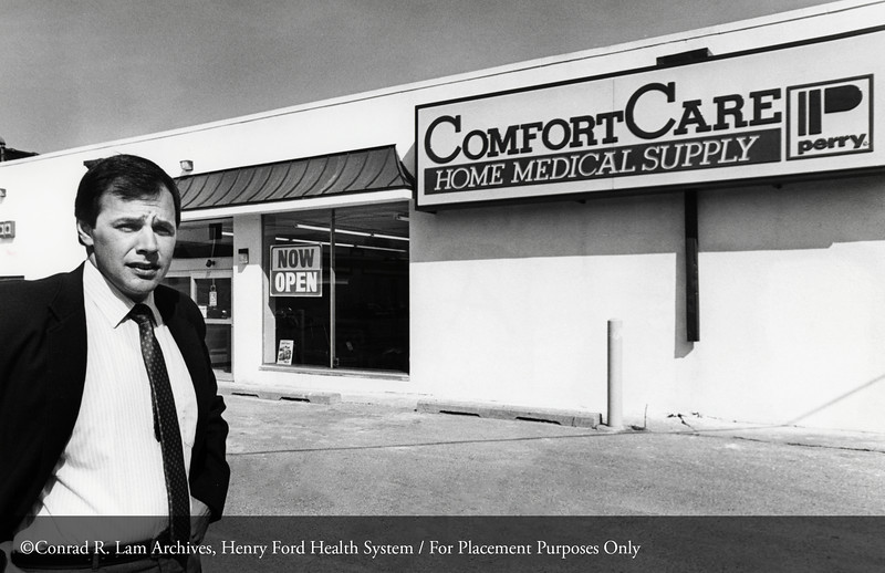 John Polanski outside Perry Comfortcare, Inc., 1985. From the Conrad R. Lam Collection, Henry Ford Health System. ID=09-011