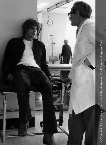 Dr. Clarence S. Livingood with Detroit Tiger baseball player, Mark Fidrych, at Henry Ford Hospital, 1977. From the Conrad R. Lam Collection, Henry Ford Health System. ID=09-002