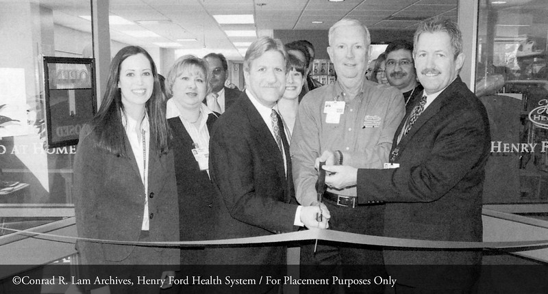 Francie Walker, Christy Weston, Jim Sexton, Greg Solecki and guests at the opening of the Wyandotte Hospital Home Health Care Store. From the Conrad R. Lam Collection, Henry Ford Health System. ID=09-026