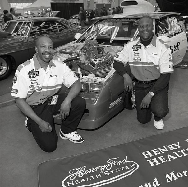 101494_626<br /> ERNEST SAWYER, RODNEY SAWYER, RACE CAR AT AUTORAMA, DETROIT, COBO HALL