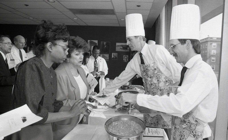"""101494_102<br /> 1st Annual  """" MEN WHO COOK """", Monica Murphy(left) served by Dr. William Conway , Dr. Gerard Martin, 1994"""