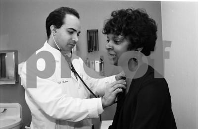 101494B_013 INTERNAL MEDICINE:  DR. RON KATTOO EXAMINING PATIENT