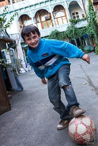 Child footballer, backstreets, Tbilisi, Georgia