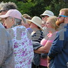 Katie Finlon for Shaw Media<br /> Sycamore History Museum secretary Jayne Higgins (left, pink hat) and other patrons listen to a volunteer give a presentation during the annual Etched in Stone Elmwood Cemetery Heritage Walk at the cemetery, 901 S Cross St.