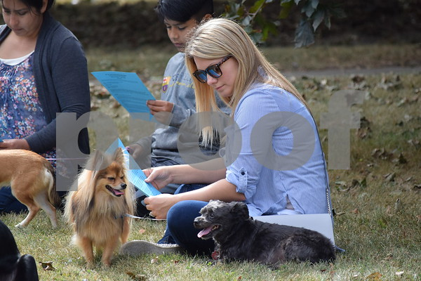 Deanna Frances for Shaw Media<br /> Milena Jones, 29, of DeKalb, sits with her dogs at the ninth annual Pet Blessing at St. Paul's Episcopal Church, 900 Normal Road in DeKalb.