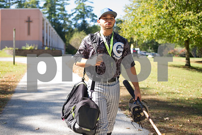 Robert Layman / Staff Photo Onil Nicholau, College of St. Joseph freshman and athlete, walks with his sports equipment Monday morning in Rutland, October 2, 2017. Nicholau, a Puerto Rican native, has had his home town of Rio Grande devastated by recent Hurricane Maria. Nicholau, who's been unable to get in contact with his father or girlfriend said he will be returning Wednesday. Nicholau said sports has been an outlet for him and has had a lot of support from coaches and teammates.
