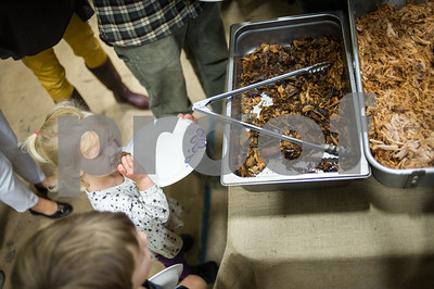 Robert Layman / Staff Photo Taurin Yoder, 2,  tries some food during the Vermont Farmer's Center's annual Harvest Fest Dinner Sunday night, October 1, 2017.