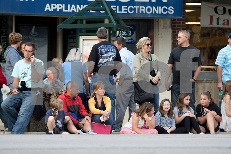 Sam Buckner for Shaw Media.<br /> Parade goers sit on State Street in Sycamore on Wednesday October 4, 2017 waiting for the parade to start.